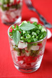 Salad with fresh radishes in a glass. Food close up Stock Photo