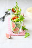 Salad with fresh ruccola and figs Royalty Free Stock Photos