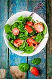 Salad with fresh spinach and strawberries with balsamic sauce and sesame Stock Image
