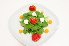 Salad with fresh spinach, strawberries, mozzarella and physalis Royalty Free Stock Photos