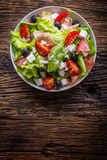 Salad. Fresh summer lettuce salad.Healthy mediterranean salad olives tomatoes parmesan cheese and prosciutto.  Stock Images