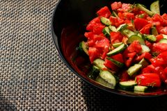 Salad of fresh tomatoes and cucumbers Stock Photo