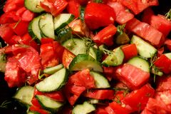 Salad of fresh tomatoes and cucumbers Stock Images