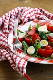 Salad with fresh tomatoes and quail eggs Royalty Free Stock Image