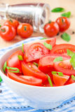 Salad from fresh tomatoes, spring green onions and black pepper Royalty Free Stock Photo