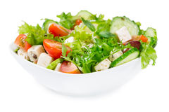 Salad with fresh vegetables in a ceramic bowl Royalty Free Stock Image