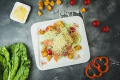 Salad with fresh vegetables, cheese, and fish. Tasty homemade food royalty free stock photo