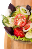 Salad of fresh vegetables close-up: cucumbers, tom Royalty Free Stock Image