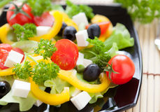 Salad with fresh vegetables and feta cheese Royalty Free Stock Photo