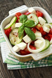 Salad with fresh vegetables and feta cheese Stock Image