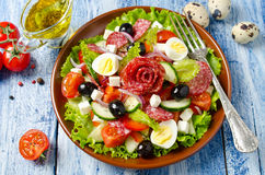 Salad with fresh vegetables, feta cheese, quail eggs, olives and Royalty Free Stock Images