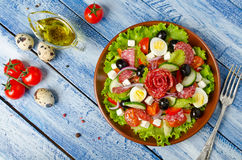 Salad with fresh vegetables, feta cheese, quail eggs, olives and Royalty Free Stock Image