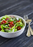 Salad with fresh vegetables, garden herbs and sun-dried tomatoes Stock Photo