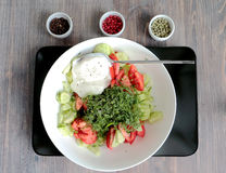 Salad - fresh vegetables and greens - dressed with white cream sauce. Three colored peppers in corns - green, rose an Stock Image
