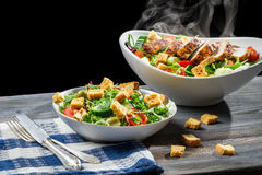 Salad from fresh vegetables and hot chicken Stock Image