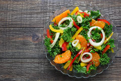Salad with fresh vegetables and mandarins Royalty Free Stock Image