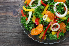 Salad with fresh vegetables and mandarins Royalty Free Stock Images