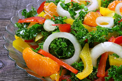 Salad with fresh vegetables and mandarins Royalty Free Stock Photos