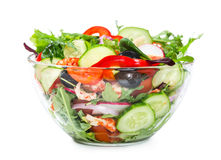 Salad with fresh vegetables, olives and shrimp isolated on white Royalty Free Stock Photography