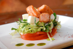 Salad from fresh vegetables with pieces of salmon Royalty Free Stock Photos