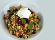 Salad of fresh vegetables, pomegranate seeds and ice cream. Top view Stock Photos