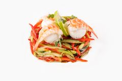 Salad of fresh vegetables with prawns on a white background side view. Isolated Stock Photo