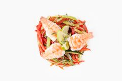 Salad of fresh vegetables with shrimps on a white background top view. Isolated Stock Images