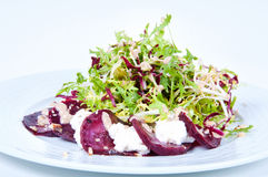 Salad with fresh vegetables spiced sauce. Stock Images