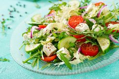 Salad of fresh vegetables - tomato, cucumber and feta cheese. In Greek style Royalty Free Stock Images