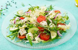 Salad of fresh vegetables - tomato, cucumber and feta cheese. In Greek style Stock Images