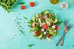 Salad of fresh vegetables - tomato, cucumber and feta cheese in Greek style. Flat lay. Top view Royalty Free Stock Photography