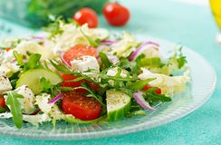 Salad of fresh vegetables - tomato, cucumber and feta cheese. In Greek style Stock Photography