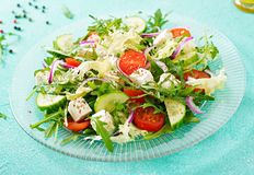 Salad of fresh vegetables - tomato, cucumber and feta cheese. In Greek style Royalty Free Stock Photography