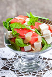 Salad  with  fresh watermelon and feta with basil and spinach lea Royalty Free Stock Image