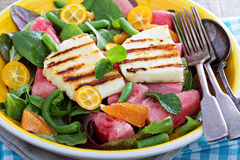 Salad with fresh watermelon and haloumi cheese. Salad with fresh watermelon, green beans, haloumi cheese and oranges Royalty Free Stock Image