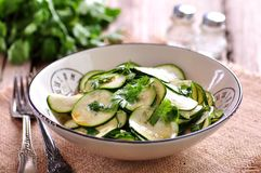 Salad of fresh zucchini with garlic, coriander, olive oil, balsamic vinegar and sea salt. Royalty Free Stock Photos