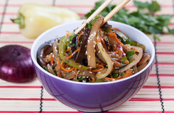 Salad of fried eggplant in Asian style. On the plate Stock Photos