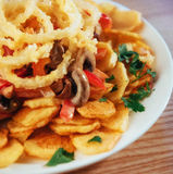 Salad with fried potatoes, mushrooms and tomatoes Stock Photos