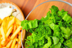 Salad and fries Stock Photo