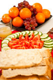 Salad, fruit and bread on a table. Royalty Free Stock Photography