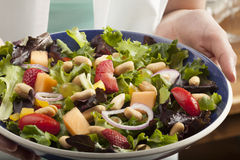 Salad with fruit and peanuts Stock Image