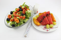 Salad and fruit plate Stock Image