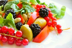 Salad with fruit and vegetables: raw food diet stock photos