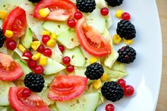 Salad with fruit and vegetables Royalty Free Stock Photos