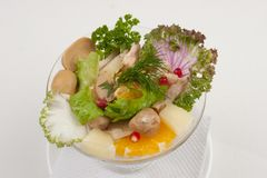 Salad with fruits and greens Royalty Free Stock Image