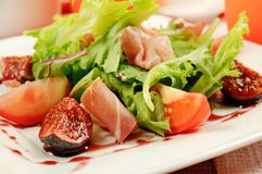 Salad with gammon and figs Stock Image