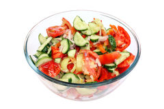 Salad in glass bowl isolated Stock Images