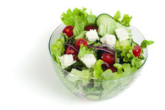 Salad in a glass bowl on a white background Royalty Free Stock Images