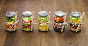Salad in glass jar Stock Photo
