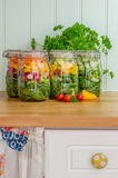 Salad in glass storage jars in kitchen. Stock Photography